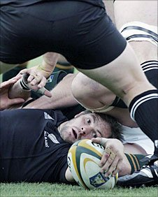 Richie McCaw presents the ball at the bottom of a ruck