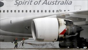 Firefighters surround the Qantas plane which made an emergency landing at Singapore's Changi Airport after having engine problems, 4 November 2010
