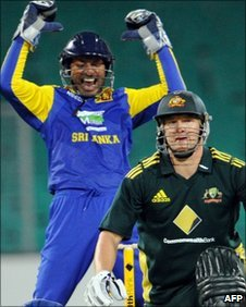 Kumar Sangakkara celebrates as Shane Watson is trapped lbw