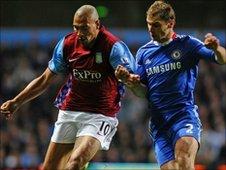 Aston Villa's John Carew (left)