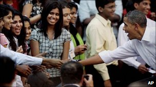 Barack Obama, right, shakes hands with students at St Xavier&#039;s College, Mumbai