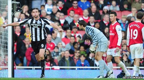 Carroll (left) profited from a mistake by Fabianski to score Newcastle's winner
