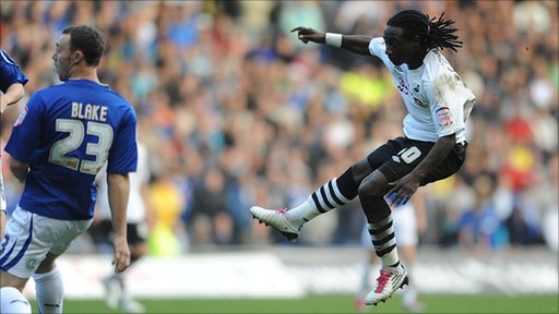 Marvin Emnes fires in Swansea's winner against Cardiff