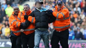 Police arrest man at a Cardiff Swansea football game