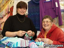 Knitters hard at work making scarves.  Photograph by Nigel Hughes