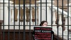 """A woman holds a poster reading """"Journalist Oleg Kashin has been beaten. I demand to find the persons who attacked him"""" during a picket at the headquarters of Moscow police department in Moscow on November 7, 2010"""