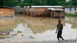 Boy near a flooded area in Leogane, Haiti (photo: Christian Aid/Susan Barry)