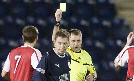 Dougie McDonald issues a yellow card on Saturday