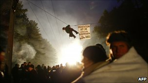 An anti-nuclear protester hangs on a rope as others block train tracks in a bid to delay the transport of nuclear waste in Gorleben, northern Germany