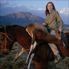 Huntress with Buck from the series Hunters by David Chancellor - courtesy of David Chancellor