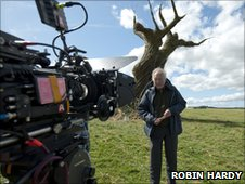 Robin Hardy filming The Wicker Tree