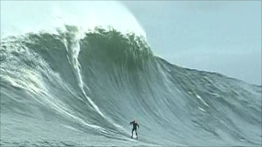 Portrush surfer Alistair Mennie rides the giant wave off the west coast of Ireland