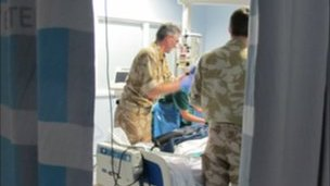 C-CAST team medics settle their patient in critical care at the QE after a flight from Kandahar.