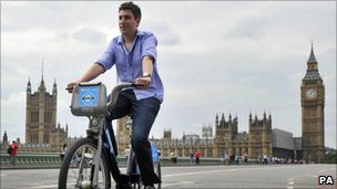 A man rides a cycle hire bike
