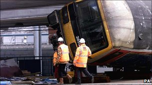 Railway workers at the scene of the crash