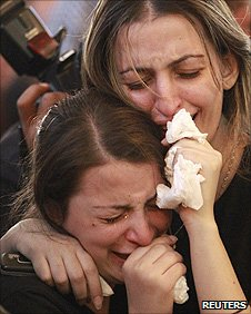 Women grieve during a funeral for victims of an attack on a Catholic catherderal in Baghdad