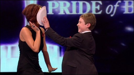 Cheryl Cole gets a custard pie in the face at the Daily Mirror Pride of Britain Awards
