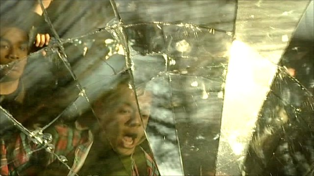 Glass being smashed by protesters