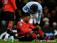 Patrice Evra (red shirt) and Carlos Tevez