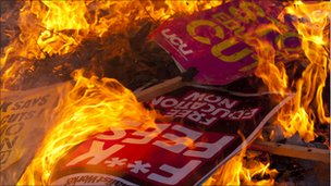 Placards burning. Photo: Jason Curtis