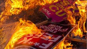 Placards burning. Photo: Jason Curtis