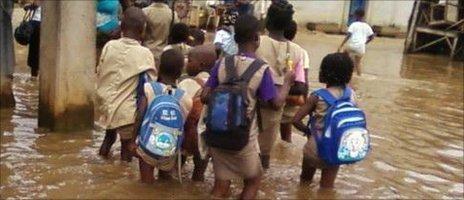 Children wading to school in Avotrou, Cotonou