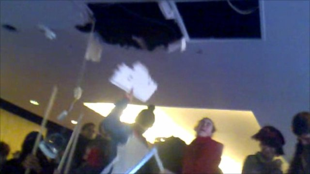 Protesters tear down the ceiling