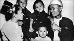 Aung San Suu Kyi (Centre, aged 2) is seen with her parents and two elder brothers in 1947