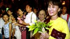 Aung San Suu Kyi walks with friends and family as she visits the Shwedagon Pagoda in Rangoon in May 2002
