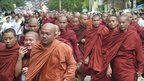 Buddhist monks, accompanied by civilians, march in protest against the military government in Rangoon in September 2007