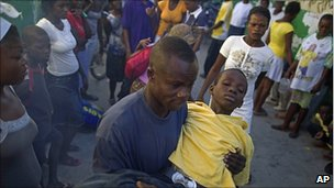 Man carries child with cholera symptoms in Port-au-Prince. 11 Nov 2010