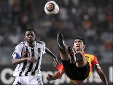 Esperance's Oussama Darragi attempts an overhead kick against TP Mazembe in a Champions League group game