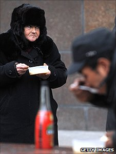 Homeless people eat handout meal in Moscow