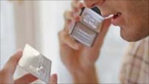 Man reads credit card details into telephone