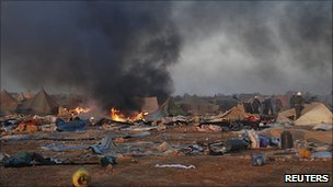 Tents burn after police raid on refugee camp near Laayoune. 8 Nov 2010