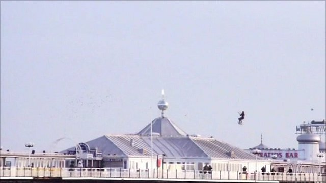 Kite surfer jumping Brighton Pier