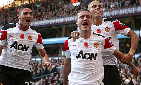 Federico Macheda (left), goalscorer Nemanja Vidic (centre) and Wes brown celebrate Man utd's equaliser at Aston Villa