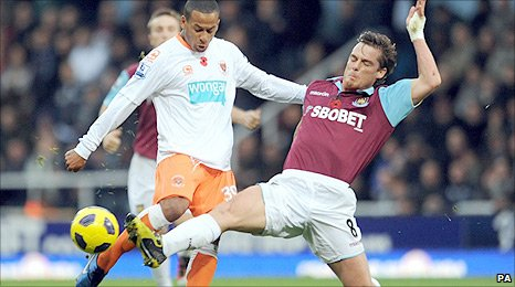 DJ Campbell and Scott Parker battle for the ball