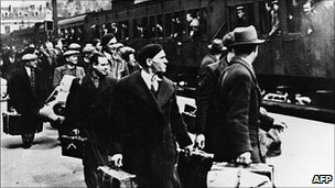 Foreign Jews travel through a station in Pithviers, central France (May 1941)