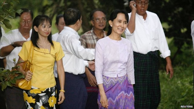 Aung San Suu Kyi walks with supporters after her release