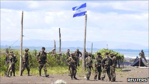 Nicaraguan troops patrol near the San Juan river on the border with Costa Rica