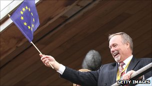 Sir Terry Matthews waves the European flag at the Ryder Cup