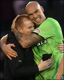 Celtic manager Neil Lennon and Daniel Majstorovic celebrate victory