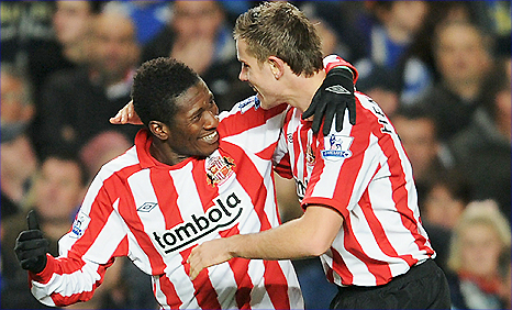 Asamoah Gyan (left) and Jordan Henderson clebrate after Sunderland's second goal at Chelsea