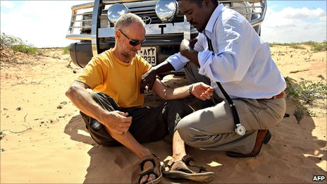 A photo made available on 28 January 2010 shows Briton Paul Chandler (left) being examined by Somali Doctor Abdi Mohamed Elmi Hangul (right) at a location in central Somalia