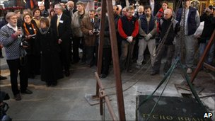 Professor Jens Vellev speaking as the tombstone of Danish astronomer Tycho Brahe is about to be lifted  at the Church of Our Lady Before Tyn, Prague 15 November 2010