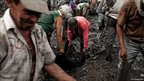 Guaqueros, or treasure hunters sift through the black earth