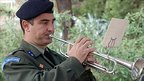 An army officer plays the trumpet. Photo: Martin Dutt