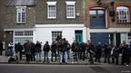 Photographers and camera crews wait for Kate Middleton to leave her Chelsea flat in London, England.