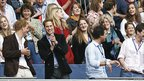 Prince Harry (left) and Prince William (second from left) smile as they watch a performance at Wembley stadium in north London, 1 July 2007. Kate Middleton is top right.